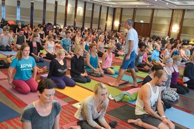 Bryan Kest teaching a full yoga class