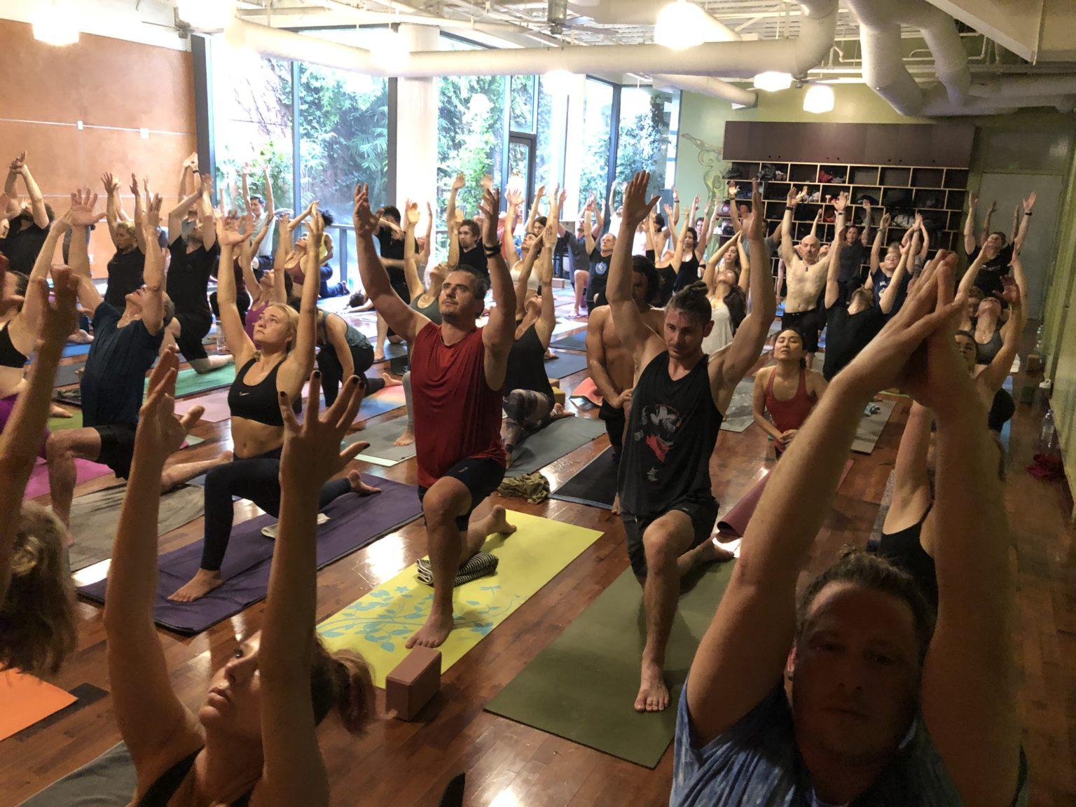 Yoga class doing lunge